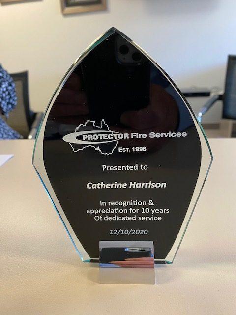 Cathy Harrison 10 year service award